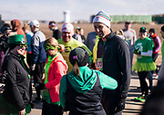 Democratic 2020 presidential candidate Beto O'Rourke, 46, speaks with supporters before running a St. Patrick's Day 5K race during a three day road trip across Iowa, in North Liberty, Iowa, U.S., March 16, 2019.  REUTERS/Ben Brewer
