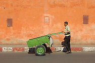 Moroccan man with green barrow