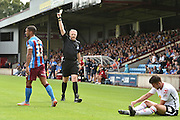 Jordan Clarke yellow card during the Sky Bet League 1 match between Scunthorpe United and Crewe Alexandra at Glanford Park, Scunthorpe, England on 15 August 2015. Photo by Ian Lyall.