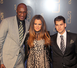 (L-R) Lamar Odom, Khloe Kardashian and Rob Kardashian arriving for the Grand Opening of Scott Disick's RYU restaurant in The Meatpacking District in New York City, NY, USA on April 23, 2012. Scott Disick has teamed up with nightlight impresario Chris Reda to introduce the Meatpacking District's hottest new restaurant, RYU that will offer Japanese-inspired cuisine and world class cocktails in a chic dining space. Photo by Charles Guerin/ABACAPRESS.COM    317673_011