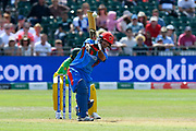Najibullah Zadran of Afghanistan hits the ball over the boundary for six runs during the ICC Cricket World Cup 2019 match between Afghanistan and Australia at the Bristol County Ground, Bristol, United Kingdom on 1 June 2019.