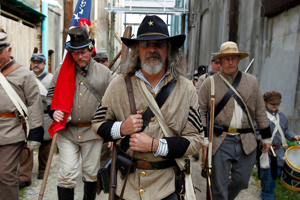 Jeff Winters heads down an alleyway with Confederate troops during a Battle of Galveston reenactment on the Strand in Galveston, Texas on Sunday, Jan. 15, 2012. The Battle of Galveston Reenactment was part of a series of events marking the 149th anniversary of the Civil War Battle of Galveston, in which Confederate troops regained control of Galveston Harbor.