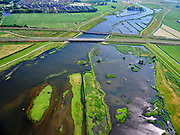 "Nederland, Overijssel, Gemeente Kampen; 21–06-2020; het Reevediep richting IJssel, gezien vanaf natuurgebied De Enk (rechtsonder). In het midden de Reevediepbrug (rijksweg N50 en parallel de Spoorbrug Reevediep.<br /> Het Reevediep is aangelegd in het kader van het project Ruimte voor de Rivier om bij hoogwater water af te voeren voordat dit het nabij gelegen Kampen bereikt, direct naar het IJsselmeer, de 'bypass Kampen'. Het Reevediepgebied is ook een natuurgebied en vormt een ecologische verbindingszone tussen rivier de IJssel en Drontermeer.<br /> Reevediep towards IJssel, seen from De Enk nature reserve (bottom right). In the middle the Reevediep Bridge with parallel the Reevediep Railway Bridge.<br /> Reevediep in the direction of river IJssel, seen from the mouth of the Reevediep.<br /> The Reevediep has been constructed as part of the Room for the River project, and functions to discharge high waters before reaching the nearby Kampen, directly to the IJsselmeer, the ""bypass Kampen"". The Reevediep area is also a nature reserve and forms an ecological connecting zone between the river IJssel and Drontermeer.<br /> <br /> luchtfoto (toeslag op standard tarieven);<br /> aerial photo (additional fee required)<br /> copyright © 2020 foto/photo Siebe Swart"