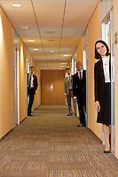 Business people standing in corridor