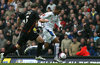 Photo: Paul Greenwood/Sportsbeat Images.<br />Leeds United v Huddersfield Town. Coca Cola League 1. 08/12/2007.<br />Huddersfield's David Mirfin (L) chases down Leeds United's Jermaine Beckford.
