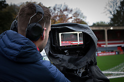 © Licensed to London News Pictures . 06/11/2015 . Salford , UK . A camera operator setting up . TV crews and volunteers at the club set up for the FA Cup match between Salford City FC and visitors Notts County , at the club's Moor Lane ground . Photo credit : Joel Goodman/LNP