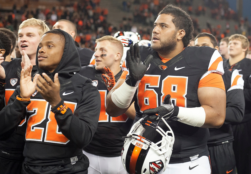 Oregon State players sing the fight sond on the field after defeating Weber State 26-7 in the 2015 season opener in Reser Stadium, in Corvallis, on Friday, Sept. 4, 2015.