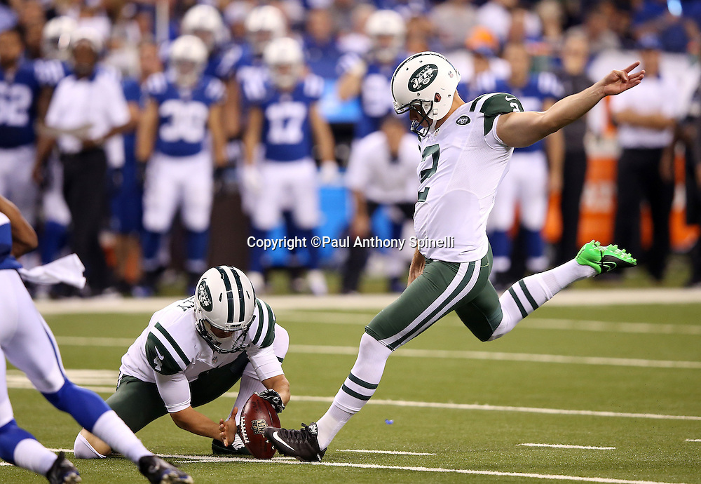 New York Jets punter Ryan Quigley (4) holds while New York Jets kicker Nick Folk (2) kicks a second quarter field goal good for a 10-0 lead during the 2015 NFL week 2 regular season football game against the Indianapolis Colts on Monday, Sept. 21, 2015 in Indianapolis. The Jets won the game 20-7. (©Paul Anthony Spinelli)