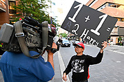 Andy Nham holds a sign to persuade Toronto Raptors free agent Kwahi Leonard to remain with the reigning NBA champions outside the Hazelton Hotel, Wednesday, July 3, 2019, in Toronto.  A large crowd was forming outside the posh downtown hotel where Raptors President Masai Ujiri had been spotted earlier in the day, with the assumption being that the hotel is where a meeting between Kawhi Leonard and the team may be taking place.  (Dylan Stewart/Image of Sport)