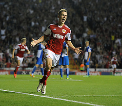 Bristol City's Joe Bryan celebrates - Photo mandatory by-line: Joe Meredith/JMP - Tel: Mobile: 07966 386802 04/09/2013 - SPORT - FOOTBALL -  Ashton Gate - Bristol - Bristol City V Bristol Rovers - Johnstone Paint Trophy - First Round - Bristol Derby