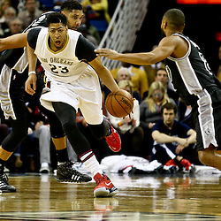 Mar 3, 2016; New Orleans, LA, USA; New Orleans Pelicans forward Anthony Davis (23) drives past San Antonio Spurs guard Patty Mills (8) during the first quarter of a game at the Smoothie King Center. Mandatory Credit: Derick E. Hingle-USA TODAY Sports