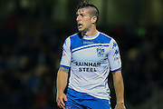 Bury FC defender Craig Jones (2) protests during the EFL Cup match between Burton Albion and Bury at the Pirelli Stadium, Burton upon Trent, England on 10 August 2016. Photo by Aaron  Lupton.