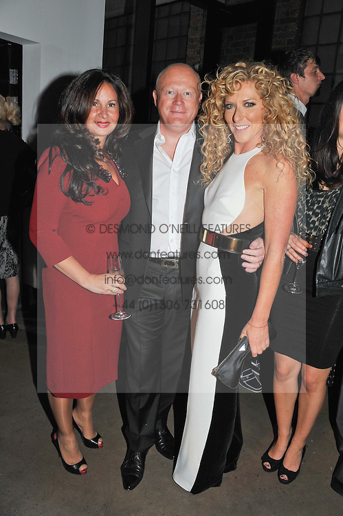 Left to riht, JANINE CAPLAN, LEO CAPLAN  CEO and owner of bespoke furniture makers Smallbone of Devizes and KELLY HOPPEN at a party to celebrate the Kelly Hoppen and Smallbone kitchen range held at The Collection, 264 Brompton Road, London on 24th September 2012.