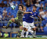 Photo: Paul Thomas.<br /> Everton v Werder Bremen. Pre Season Friendly. 31/07/2007.<br /> <br /> Tim Cahill of Everton battles with Diego (L).