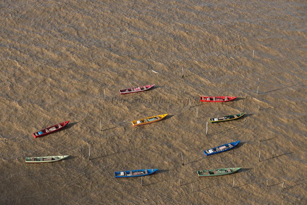 Fishing boats<br /> Atlantic Ocean<br /> Shell Beach<br /> North GUYANA<br /> South America