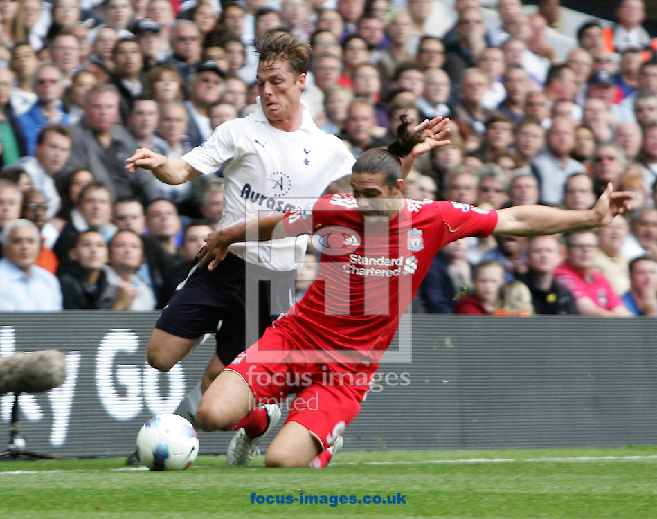 Picture by Paul Terry/Focus Images Ltd..18/9/11.Scott Parker of Tottenham is challenged by Andy Carroll of Liverpool during the Barclays Premier League match at White Hart Lane stadium, London.