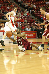 19 November 2005: Jesse McClung gathers up a loose ball in a non-conference race that came down to a photo finish. The Illinois State Redbirds slipped past the Indianapolis University Greyhounds 54-50 at Redbird Arena in Normal Illinois