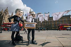 © Licensed to London News Pictures. 12/09/2017. London, UK. Campaigners from Avaaz dressed as Rupert Murdoch and Theresa May demonstrate outside Parliament against Rupert Murdoch's proposed takeover of Sky. Culture Secretary Karen Bradley has referred the £11.7bn deal to regulators over media plurality and broadcasting standards. Photo credit: Rob Pinney/LNP