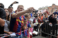 Fans of FC Barcelona wait for players after press conference in The Polish Baltic Frédéric Chopin Philharmonic in Gdansk, Poland.<br /> A few hours before friendly match between Lechia Gdansk and FC Barcelona.<br /> <br /> Poland, Gdansk, July 30, 2013<br /> <br /> Picture also available in RAW (NEF) or TIFF format on special request.<br /> <br /> For editorial use only. Any commercial or promotional use requires permission.<br /> <br /> Photo by © Adam Nurkiewicz / Mediasport