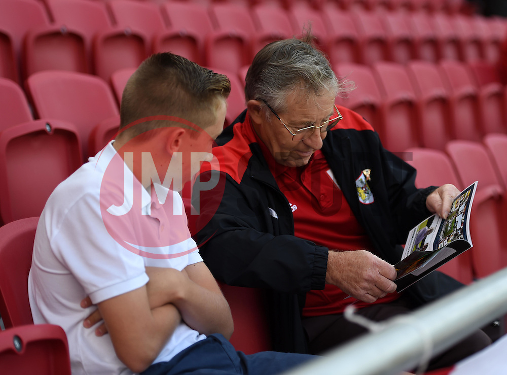 Supporters review the matchday programme in their seats at the South Stand - Mandatory by-line: Paul Knight/JMP - Mobile: 07966 386802 - 15/08/2015 -  FOOTBALL - Ashton Gate Stadium - Bristol, England -  Bristol City v Brentford - Sky Bet Championship