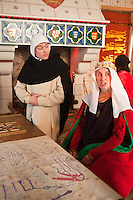 Actors dressed as medieval characters act out their roles in the Medieval Castle at the Tower of London, London, England.
