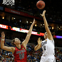 Apr 9, 2013; New Orleans, LA, USA; Connecticut Huskies center Stefanie Dolson (31) shoots against Louisville Cardinals forward Sara Hammond (00) during the first half of the championship game in the 2013 NCAA womens Final Four at the New Orleans Arena. Mandatory Credit: Derick E. Hingle-USA TODAY Sports