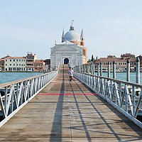 VENICE, ITALY - JULY 16: The Redentore church seen from the temporary 330mt long  pontoon brdige on July 16, 2011 in Venice, Italy. Redentore is the celebration most loved by Venetians, to remind the end of the plague in 1577 higlights of the celebration are the poonton bridge across the Giudecca Canal, people gatherings on boats in the St Mark's basin and spectacular fireworks display.