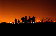 Refugees from Afghanistan and Iraq , who are trying to cross the channel tunnel to England, make their way by night from Calais to the outskirts of the city where they sleep in old WWII bunkers because the refugee camp in Sangatte has been closed by French authorities. The closing of the refugee camp stemmed from an agreement between the French and British governemnts in an effort to stop the flow of illegal immigrants crossing the channel tunnel. Humanitarian aid workers provide the refugees with warm clothes, food and blankets to help them endure the sub-freezing temperatures. (Photo © Jock Fistick)