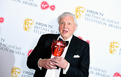 Sir David Attenborough with the award for Virgin TV's Must-see moment in the press room at the Virgin TV British Academy Television Awards 2018 held at the Royal Festival Hall, Southbank Centre, London.