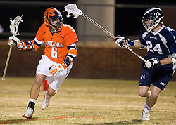Virginia Cavaliers A Steele Stanwick (6) is defended by Mt. Saint Mary's D Russell Moncure (24).  The #2 ranked Virginia Cavaliers defeated the Mt. Saint Mary's Mount 10-2 at the University of Virginia's Klockner Stadium in Charlottesville, VA on February 24, 2009.   (Special to the Daily Progress / Jason O. Watson)