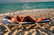 MEXICO, QUINTANA ROO 'Riviera Maya', sunbather on beach