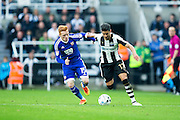 Newcastle United forward Ayoze Perez (#17) takes on Brentford midfielder Ryan Woods (#15) during the EFL Sky Bet Championship match between Newcastle United and Brentford at St. James's Park, Newcastle, England on 15 October 2016. Photo by Craig Doyle.