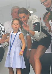The Duchess of Cambridge with Princess Charlotte look through a window at the prize giving after the King's Cup regatta at Cowes on the Isle of Wight.