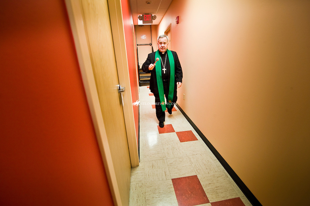 Archbishop Robert J. Carlson walks through the hallway and blesses the new wing of Fr. Dempsey's Charities building.  The new wing provides an additional 8 rooms of transitional housing for those in need.  The average length of stay in a room is about one year.