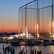Chelsea Piers Golf Driving Range at Twilight on the Hudson River in New York City, NY. Chelsea Piers is a series of historic piers on the West Side of Manhattan that was a passenger ship terminal in the early 1900's. It was converted to the Chelsea Piers Sports & Entertainment Complex in the 1990's.