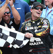 Jeff Gordon celebrates his fifth Brickyard 400 win at the Indianapolis Motor Speedway  Sunday, July 27, 2014.