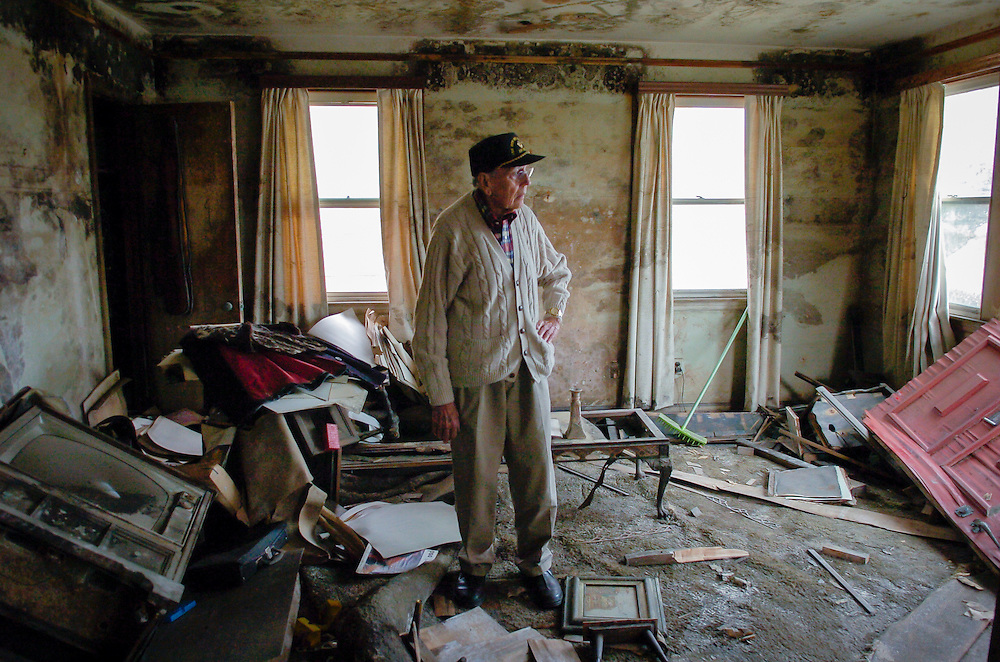 """My future is behind me now,"" Irwin Buffet, 88, said as he looked around the living room of his New Orleans home which was destroyed by Hurricane Katrina and the subsequent levee failure. Like many elderly residents daunted by the prospect of rebuilding their flooded homes, Buffet lost all hope of coming back. At his funeral ten months later his daughter, Janice Shreve, told friends that her father was a victim of Hurricane Katrina. ""He died of a broken heart,"" she told them. www.kathyandersonphotography.com"