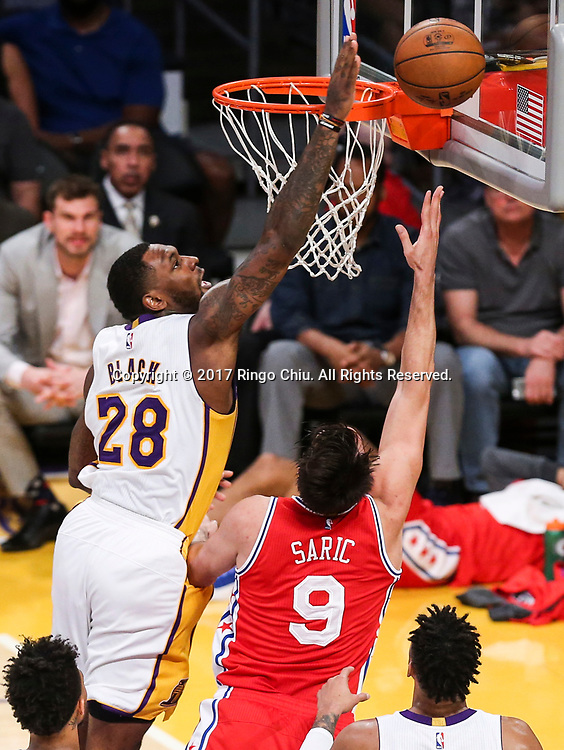 Los Angeles Lakers center Tarik Black (#28) blocks a shot by Philadelphia 76ers forward Dario Saric (#9) during an NBA basketball game Tuesday, March 12, 2017, in Los Angeles. <br /> (Photo by Ringo Chiu/PHOTOFORMULA.com)<br /> <br /> Usage Notes: This content is intended for editorial use only. For other uses, additional clearances may be required.
