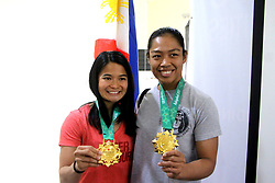 October 3, 2017 - Philippines - Two Filipina Jiu jitsu Gold Medalist Annie Ramirez from 5th Asian Indoor and Martial Arts Games (rigt) and Meggie Ochoa from winning 5th Asian Indoor and Martial Arts Games in Turkmenistan, Rusia (left) showed their medal after the press conferences of introduction of the new Philippine Sports Commission Executive Director and new Philippine Sports Commission Chief of Staff at Athletes Dining Hall, Rizal Memorial Sports Complex in Manila City on October 3, 2017. (Credit Image: © Gregorio B. Dantes Jr/Pacific Press via ZUMA Wire)
