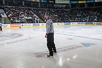 KELOWNA, CANADA - APRIL 25:  Bevan Mills, linesman, stands on the ice at the # of the Kelowna Rockets on April 25, 2014 during Game 5 of the third round of WHL Playoffs at Prospera Place in Kelowna, British Columbia, Canada. The Portland Winterhawks won 7 - 3 and took the Western Conference Championship for the fourth year in a row earning them a place in the WHL final.  (Photo by Marissa Baecker/Getty Images)  *** Local Caption *** Bevan Mills; linesman; officials;