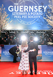 Lily James (left) and Glen Powell attending The Guernsey Literary and Potato Peel Pie Society world premiere held at Curzon Mayfair, London.
