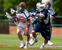 Virginia Cavaliers A Matt Kugler (35) is defended by Villanova Wildcats Defense Chris Ficke (15).  The #5 ranked Virginia Cavaliers defeated the #19 ranked Villanova Wildcats 18-6 in the first round of the 2008 NCAA Men's Lacrosse Tournament the University of Virginia's Klockner Stadium in Charlottesville, VA on May 10, 2009.