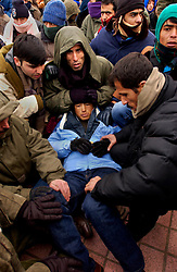 CALAIS, FRANCE  - DEC-10-2002 - Refugees from Afghanistan and Iraq gathered in the city center of Calais in sub-freezing temperatures to stage a demonstration and demanded passage to England. The refugees refused an offer from the UNHCR to claim political asylum in France. The refugees also refused food and blankets from humanitarian aid workers and refused medical help from emergency medical personel. At midnight the police removed the refugees by force, and transported them by bus to various locations in France. (PHOTO © JOCK FISTICK).