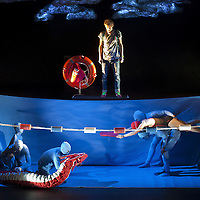 World Premiere<br /> Vox Motus, National Theatre of Scotland and Tianjin People&rsquo;s Art Theatre (China)<br /> present DRAGON. Written by Oliver Emanuel. Conceived by Jamie Harrison, Oliver Emanuel and Candice Edmunds.<br /> <br /> Picture shows : <br /> Scott Miller as Tommy and Joanne McGuinness (the swimmer) as Susie.<br /> <br /> <br /> &copy; Drew Farrell Tel : 07721-735041<br /> <br /> This image is free to be used  to promote the production and The National Theatre of Scotland. <br /> Permissions for all other uses must be approved and this production.<br /> <br /> Directed by Candice Edmunds and Jamie Harrison, designed by Jamie Harrison, puppet design by Jamie Harrison and Guy Bishop, music composed by Tim Phillips, lighting design by Simon Wilkinson, sound design by Mark Melville and assistant director Guo Yan.<br />  <br /> Vox Motus, National Theatre of Scotland, and Tianjin People&rsquo;s Art Theatre (China) present the world premiere of Dragon - a spectacular piece of theatre without words for adults, teenagers and children, marking the first co-production between the three companies. Two Chinese physical artists from Tianjin People&rsquo;s Art Theatre (China) are joining the company, bringing a unique international dimension to this groundbreaking production.  There are plans for the play to be produced in China in 2014.<br /> <br /> Dragon opens at the Citizens Theatre, Glasgow from 11 October to 19 October and tours to Eden Court, Inverness from 22 to 26 October; Traverse Theatre, Edinburgh from 30 October to 2 November and The Quays Theatre, The Lowry, Salford on 8 and 9 November 2013 with a press performance at the Citizens Theatre on Tuesday 15 October at 7pm.<br /> <br /> The production features leading Scottish actors and puppeteers as well as marking the professional stage debut for Scott Miller. <br /> <br /> Cast:  Martin McCormick, Joanne McGuinness, Scott Miller, Adura Onashile, Gavin Jon Wright, <br /> Zhang Kai and Tao Yan<br /> <br /> Press contacts:<br /> Jo Lennie &ndash; Freelance Publicist &ndash; jo.lennie@ntlworld.com M: 07708 980 918<br /> <br /> Emma Schad - Press Manager - emma.schad@nationaltheatrescotland