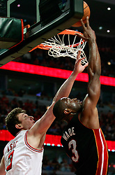 15.05.2011, UNITED CENTER, CHICAGO, USA, NBA, Chicago Bulls vs Miami Heat, im Bild Dwyane Wade (R) shoots against Chicago Bulls center Omer Asik of Turkey (L) in game 1 of the NBA Eastern Conference Championships at the United Center in Chicago, EXPA Pictures © 2011, PhotoCredit: EXPA/ Newspix/ KAMIL KRZACZYNSKI +++++ ATTENTION - FOR AUSTRIA/ AUT, SLOVENIA/ SLO, SERBIA/ SRB an CROATIA/ CRO, SWISS/ SUI and SWEDEN/ SWE CLIENT ONLY +++++