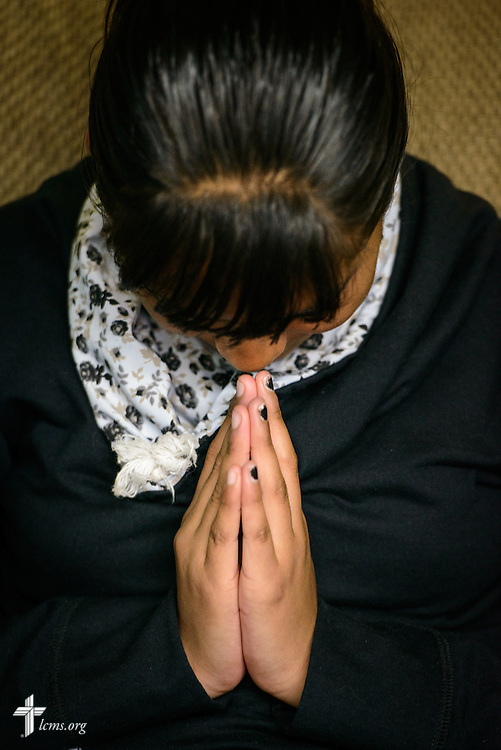 A young adult prays during catechesis at the Lutheran Church of The Good Shepherd on Saturday, Feb. 13, 2016, in Mexico City, Mexico. LCMS Communications/Erik M. Lunsford