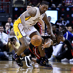 March 10, 2011; Miami, FL, USA; Los Angeles Lakers small forward Ron Artest (15) steals the ball from Miami Heat shooting guard Dwyane Wade (3) during the second quarter at the American Airlines Arena.  Mandatory Credit: Derick E. Hingle