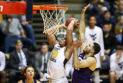 Feb 12, 2018; Morgantown, WV, USA; West Virginia Mountaineers forward Sagaba Konate (50) attempts to dunk and is fouled by TCU Horned Frogs forward Ahmed Hamdy-Mohamed (23) during the second half at WVU Coliseum. Mandatory Credit: Ben Queen-USA TODAY Sports