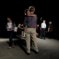 TAMPA, FL -- October 25, 2010 -- Jacey Feiler, 8, rests in the arms of her father, John, of brandon, after listening to Republican candidate for governor Rick Scott greet supporters at a post-debate rally in Tampa, Fla., on Monday, September 25, 2010.  Scott was kicking off his final week of campaigning in the heated race for Florida Governor against Democrat Alex Sink.
