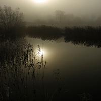 Sun rising over the water meadows at Eye, Suffolk, England